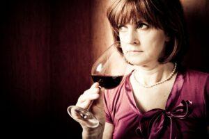 Women in her 50s drinking wine